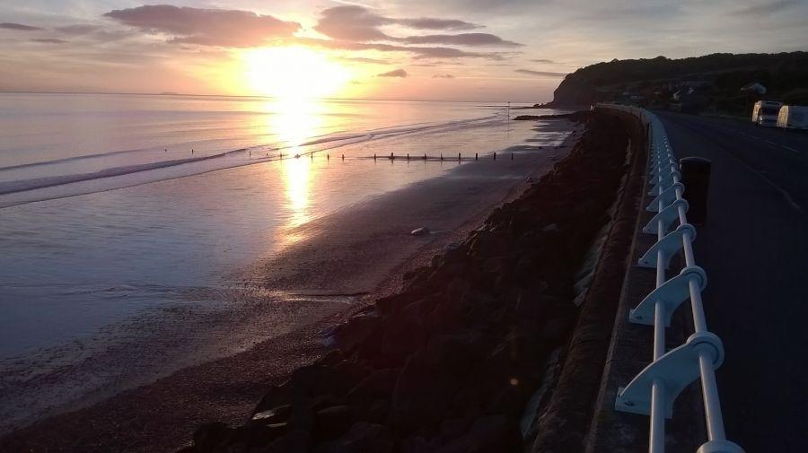 Sunrise-over-the-sea-beside-the-camp-site-at-Blue-Anchor