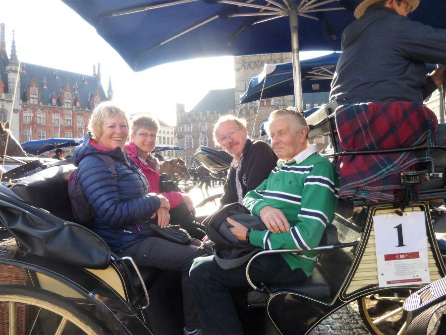 BL111-Jane-Judy-David-Duncan-in-carriage-at-Brugge