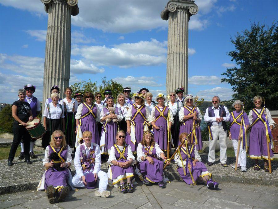 Swanage-Raddon-Hill-and-Fleur-de-Lys-Stave-Dancers-by-Roman-pillars